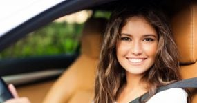 A young woman in her car