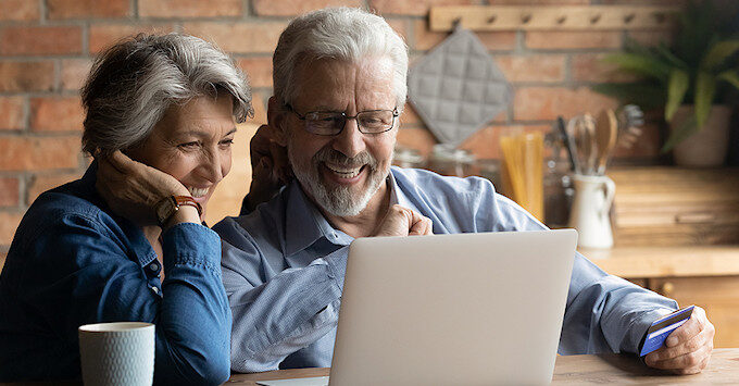 Mature couple shopping for home insurance online