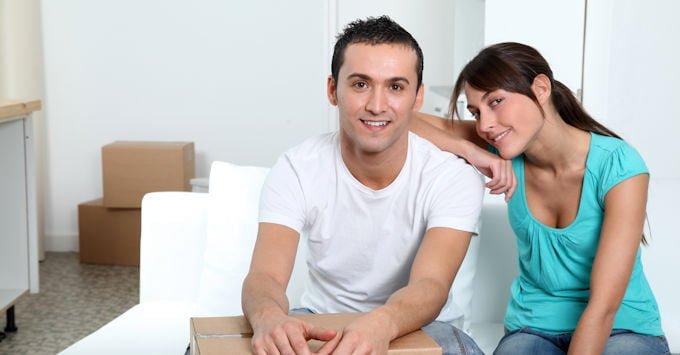 Young couple in their new apartment